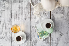 Romantic evening, coffee, cognac and undressed bra on table Royalty Free Stock Images