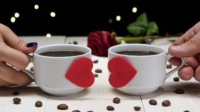 Romantic evening. Couple of people in love. Cup of coffee stock footage
