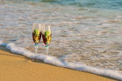 Summer travels. Glass on the sand royalty free stock photo