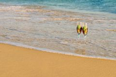 Summer travels. Glass on the sand stock image