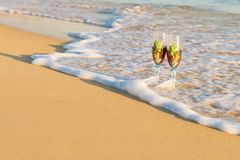 Summer travels. Glass on the sand royalty free stock image
