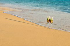 Summer travels. Glass on the sand stock images