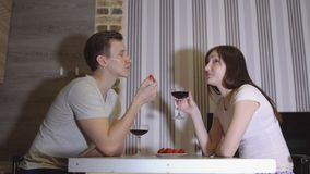Romantic evening. Man and woman at the table drinking wine stock video footage