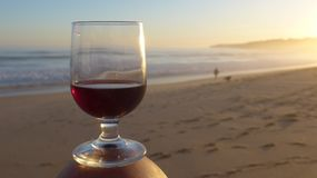 Romantic evening mood at the sea with a glass of red wine. stock photography
