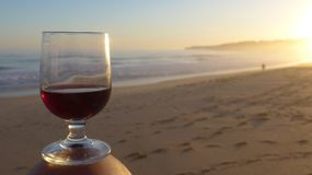 Romantic evening mood at the sea with a glass of red wine. stock images