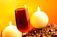 Romantic Evening - Red Wine and Burning Candles Royalty Free Stock Photography