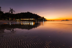 Romantic Evening on a tropical island with night illumination. Royalty Free Stock Image