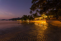 Romantic Evening on a tropical island with night illumination. Stock Photos