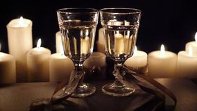 Romantic evening with two glasses of wine with lighted candles, HD. Romantic evening with two glasses of wine with lighted candles stock video