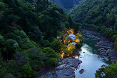 Romantic evening view of lights along the Katsura River in Kyoto, Japan moments before sunset Royalty Free Stock Image