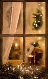 Romantic evening winter scene with old window