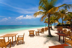 Romantic exotic restaurant on the tropical beach in Maldives Royalty Free Stock Photo