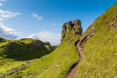 Romantic Fairy Glen. Mystic Fairy Glen, a romantic green valley with strange stone structures on the Isle of Skye, Scotland Royalty Free Stock Photos