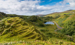 Romantic Fairy Glen. Mystic Fairy Glen, a romantic green valley with strange stone structures on the Isle of Skye, Scotland Royalty Free Stock Image