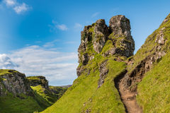 Romantic Fairy Glen. Mystic Fairy Glen, a romantic green valley with strange stone structures on the Isle of Skye, Scotland Stock Photo