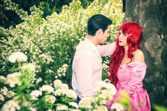 Romantic Fairy Tale Couple Sitting in Garden among Stock Photography