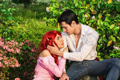 Romantic Fairy Tale Couple Sitting in Garden among Stock Images