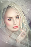 Romantic fairy woman closeup. Romantic fairy woman in a veil of white hair Stock Photo