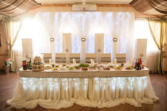 Romantic fairytale catered white table at wedding reception with Stock Photos