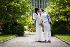 Romantic fairytale married couple in white clothes holding hands Royalty Free Stock Images