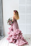 Romantic fashion woman in a pink dress and bouquet. royalty free stock photos