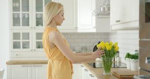 Romantic female composing bouquet stock video footage