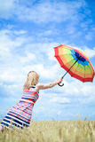 Romantic female flying with umbrella in the wheat Royalty Free Stock Photos