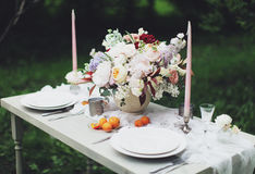 Romantic festive dinner for two. Romantic wedding dinner for two in pastel shades stock images