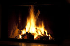 Romantic fire. In the fireplace at home Stock Photo