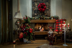 Romantic fireplace and christmas decorations at home Stock Images
