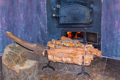 Romantic fireplace firewood Stock Photography