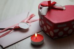 Romantic flatlay with candle, letter and box royalty free stock images