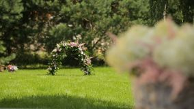 Romantic floral composition for a wedding or special event, white and pinky stock video