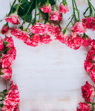 Romantic floral roses frame vintage background. Pink roses on a wooden background Royalty Free Stock Images