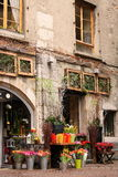 Romantic flower shop. Stone house with flower shop in France stock photo