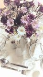 Romantic flowers. On restaurant table Royalty Free Stock Image