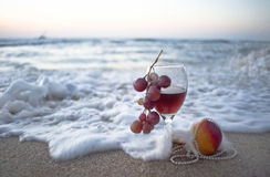 The Romantic Foam. Wine and fruit in the Mediterranean waves Stock Images