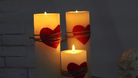 Romantic footage of Three candles lights. White Candles whith red heart Burning Peacefully stock video