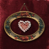 Romantic framework ancient. Heart in an old frame hanging on the wall Royalty Free Stock Photos