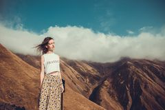 Romantic free dreamy woman with closed eyes, hair wind enjoy harmony with nature. Peace of mind. Happy dreamer, inspiration backgr. Ound. Mountain landscape. T Royalty Free Stock Photo