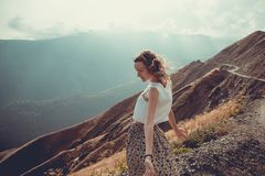 Romantic free young woman with hair wind enjoy harmony with nature and fresh air. Peace of mind. Happy tranquil girl, inspiration. Background. Mountain royalty free stock image