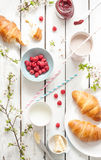 Romantic french or rural breakfast with croissants, jam and raspberries on white Royalty Free Stock Photo