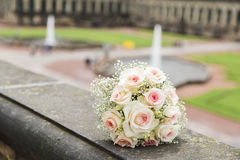 Romantic fresh wedding bouquet on background of old castle. Romantic wedding fresh colorful bouquet in a daylight on the background of old baroque historical stock photography