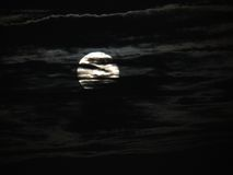 Romantic Full Moon behind clouds Royalty Free Stock Photography