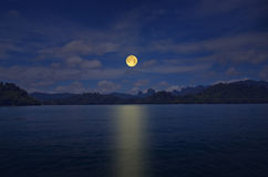 Romantic full moon night over peace lake Royalty Free Stock Photography