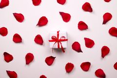 Beautiful bright red rose petals on solid white background. Happy valentines day oliday sales concept. Romantic gesture, love confession, happy valentines day Stock Photography