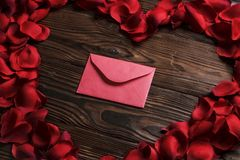 Beautiful bright red rose petals on wooden background. Happy valentines day oliday sales concept. Romantic gesture, love confession, happy valentines day Stock Photography