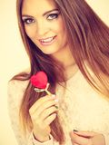 Flirty woman holding red wooden heart on stick. Romantic gestures, valentines gifts ideas concept. Happy flirty woman holding red wooden heart on stick royalty free stock photos