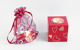 Romantic gift. Gift inside special bag with romantic candle Stock Photography