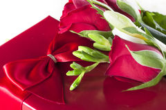 Romantic Gift. Romantic red gift with red roses Stock Photos